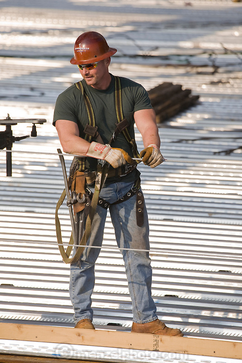 Ironworker Jeff Devine at work at a construction site on 300 East Randolph St., Chicago, Illinois. (Jeff Devine is featured in the book What I Eat: Around the World in 80 Diets.) MODEL RELEASED.