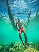 Tufi, Papua New Guinea, rigged canoe with a free diver
