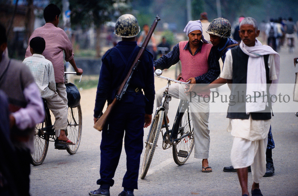 Nepalganj, 22 February 2005.  At 3 kilometres from the Indian border, the Armed Police Force are checking locals for hand grenades.
