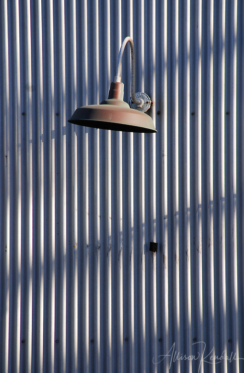Late afternoon light casts shadows across corrugated metal siding, a graceful lamp adds interest in an industrial area of Monterey<br /> <br /> Prints: https://bit.ly/industrial-texture