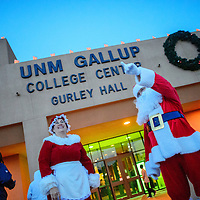 """120114  Adron Gardner/Independent<br /> <br /> Jenine Stiger as, Mrs. Claus, and Wyatt Stiger, as Santa Claus greet visitors to Gurley Hall for """"Holiday in New Mexico"""" festivities at the University of New Mexico in Gallup Monday.<br /> <br /> <br /> <br />  <br /> Santa <br /> <br /> <br /> Kimberly Hayes<br /> Violin<br /> <br /> <br /> Sheryl McClure"""