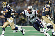 New England Patriots defensive linemen Ty Warren (94) reaches out for St. Louis Rams quarterback Marc Bulger (L) during the first quarter at the Edward Jones Dome in St. Louis, Missouri.  The Patriots beat the Rams 40-22, November 7, 2004.