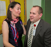 Claire Frazier, left, is congratulated by principal Dr. Steven Shetzer, right, after being awarded the Chevalier dans Ordre des Palmes Academiques by France Cultural Attache Sylvie Christophe at Kolter Elementary School, November 20, 2013.