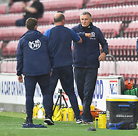Blackburn Rovers' Manager Tony Mowbray and Wigan Athletic's Manager Paul Cook bump elbows at the final whistle<br /> <br /> Photographer Dave Howarth/CameraSport<br /> <br /> The EFL Sky Bet Championship - Wigan Athletic v Blackburn Rovers - Saturday 27th June 2020 - DW Stadium - Wigan<br /> <br /> World Copyright © 2020 CameraSport. All rights reserved. 43 Linden Ave. Countesthorpe. Leicester. England. LE8 5PG - Tel: +44 (0) 116 277 4147 - admin@camerasport.com - www.camerasport.com