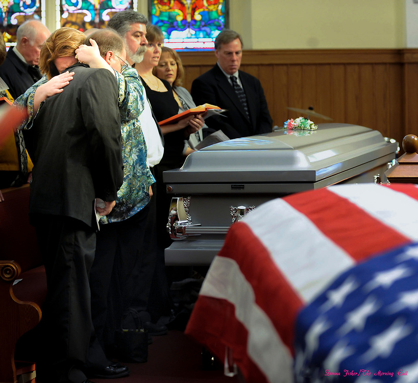 At memorial service at Salem United Methodist Church for Bill and Bea Hall, victims of last Wednesday's blast at 13th and Allen, Pastor James Anderman, right, conducts the service as Mark Hall, son of the deceased couple, left, is comforted by his wife Michelle Hall.  Gas explosion at 13th and Allen Streets, Allentown, Pa. which happened on the night of February 9, 2011. Scene at 13th and Allen.   ////            DONNA FISHER/THE MORNING CALL     ALLENTOWN