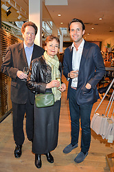 Left to right, SIR NIGEL & LADY SHEINWALD and CHARLIE GILKES at a party to celebrate the publication of The Naturalista by Xochi Balfour held at Anthropologie, 158 Regent Street, London on 19th April 2016.