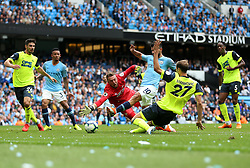 Manchester City's Sergio Aguero (centre) scores his side's third goal of the game