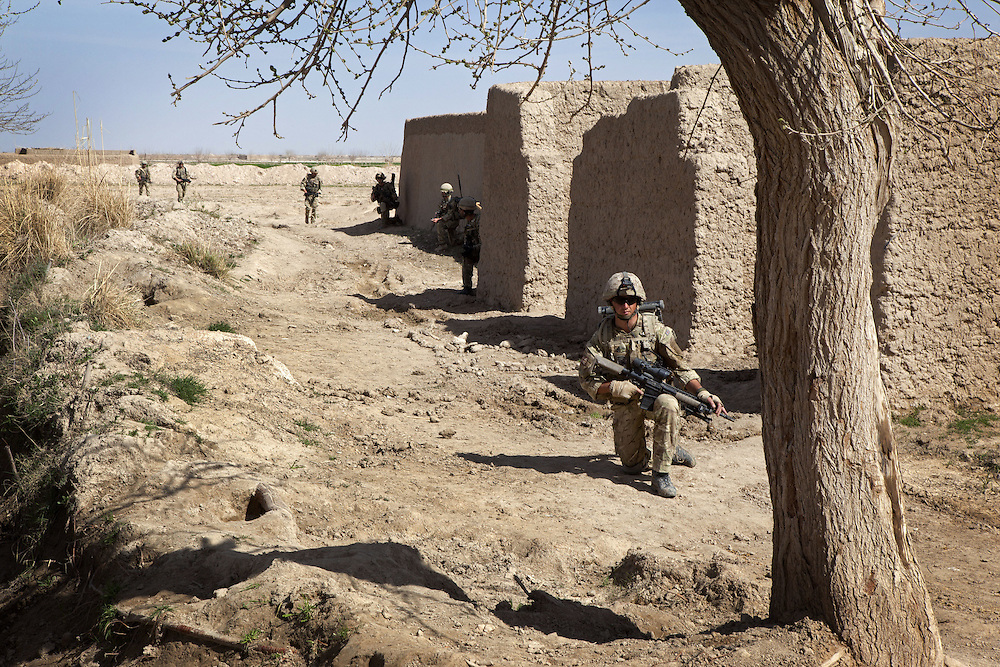 British soldiers of 16 Air Assault Bde's elite BRF (Brigade Reconnaissance Force) move from compound to compound searching for weapons and explosives as part of an operation in the village of Kakaran in Helmand Province, Southern Afghanistan on the 14th of March 2011.
