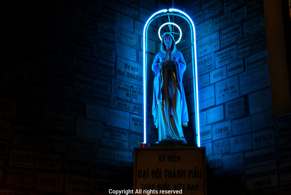 Statue of Neon Virgin Mary intside Notre Dame Ho Chi Minh city
