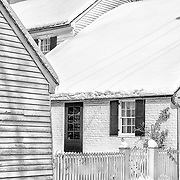 Snow covers the roofs of out-buildings on the Mary Washington House historic property in Fredericksburg, VA.