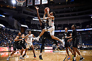 Connecticut's James Bouknight goes up for a basket as Central Florida's Collin Smith defends in the second half of an NCAA college basketball game, Wednesday, Feb. 26, 2020, in Hartford, Conn. (AP Photo/Jessica Hill)