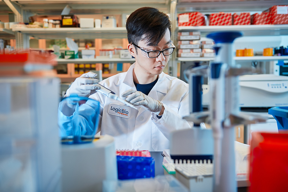 LogicBio lab worker in a lab environment .