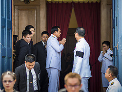 October 14, 2016 - Bangkok, Bangkok, Thailand - GENERAL PRAYUTH CHAN-O-CHA, The Prime Minister of Thailand, leaves the Sahathai Samakom Pavilion at the Grand Palace after paying respects to Bhumibol Adulyadej, the King of Thailand, who died Oct. 13, 2016. He was 88. His death comes after a period of failing health. Prayuth organized the coup that deposed Yingluck Shinawatra. With the king's death, the world's longest-reigning monarch is Queen Elizabeth II, who ascended to the British throne in 1952. Bhumibol Adulyadej, was born in Cambridge, MA, on 5 December 1927. He was the ninth monarch of Thailand from the Chakri Dynasty and is known as Rama IX. He became King on June 9, 1946 and served as King of Thailand for 70 years, 126 days. He was, at the time of his death, the world's longest-serving head of state and the longest-reigning monarch in Thai history. (Credit Image: © Jack Kurtz via ZUMA Wire)