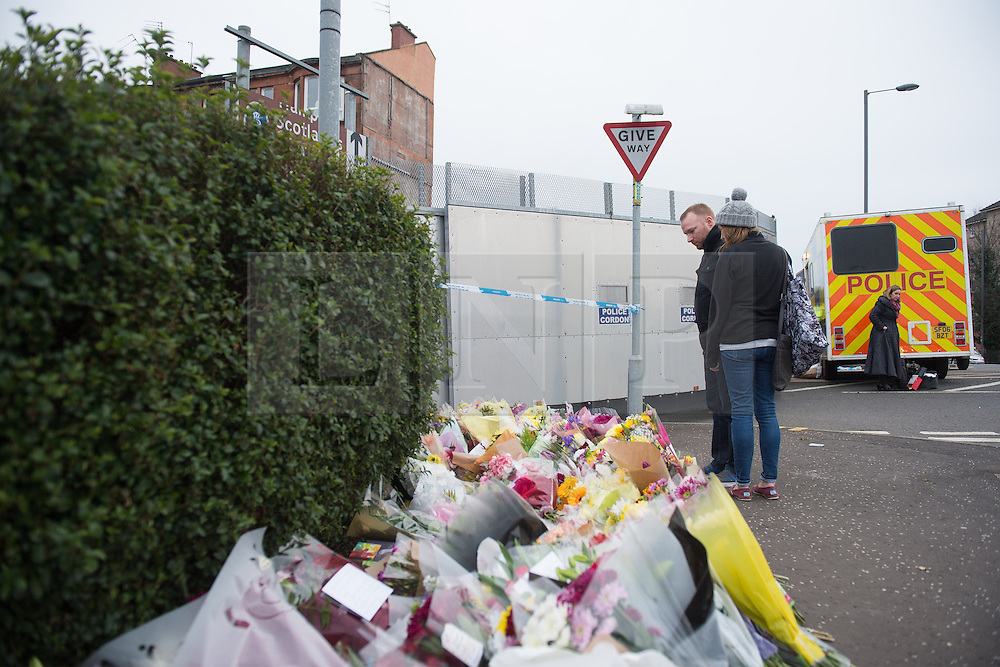 © Licensed to London News Pictures. 25/03/2016. <br /> <br /> Pictured: Floral tributes at the scene.<br /> <br /> Police Scotland have arrested a 32 year old man in connection with the death of 40 year old shopkeeper Asad Shah after he was attacked outside his shop in Minard Road, The Shawlands, Glasgow on Thursday 24th March 2016.<br /> <br /> Police Scotland have announced they are treating the death as 'Religiously Prejudced'<br /> <br />  Photo credit should read Max Bryan/LNP