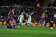 Swansea city's Nathan Dyer is sent flying by a tackle from Joe Ledley of Palace. Barclays Premier league, Swansea city v Crystal Palace match at the Liberty Stadium in Swansea, South Wales on Sunday 2nd March 2014.<br /> pic by Andrew Orchard, Andrew Orchard sports photography.