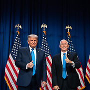 CHARLOTTE, NC - August 24:  President Donald Trump and Vice President Mike Pence appear on stage together inside the Charlotte Convention Center during the 2020 Republican National Convention being held in uptown Charlotte on August 24, 2020. The 1 day, in person convention began Monday afternoon and will end the same day after the party official re-nominates President Donald Trump and Vice President Mike Pence. The rest of the convention will go virtual. (Photo by Logan Cyrus for AFP)