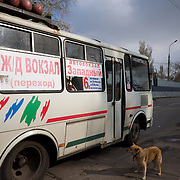 DONETSK, UKRAINE - OCTOBER 22, 2014: A bus is seen leaving Kievskiy district, one of the neighbourhoods of Donetsk most affected by the fighting between rebel forces and the Ukrainian army. CREDIT: Paulo Nunes dos Santos