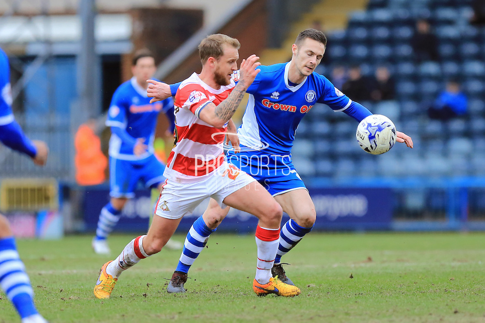 James Coppinger, Michael Rose during the Sky Bet League 1 match between Rochdale and Doncaster Rovers at Spotland, Rochdale, England on 2 April 2016. Photo by Daniel Youngs.