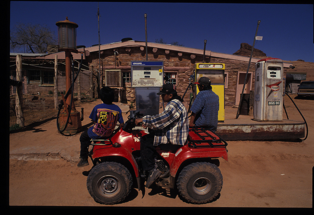 Gasing-up at the Oljato Trading Post.  From left: Bradley (10), Herman (15) and Berkeley Chee (12).