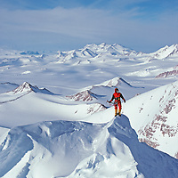 ANTARCTICA, Queen Maud Mountains. Vern Tejas (MR) on false summit of 10,302-foot Mount Vaughan, near the South Pole in the Queen Maud Mountains, part of the vast Trans-Antarctic Mountains.  Mount Goodale bkg.
