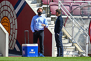 Heart of Midlothian manager Robbie Neilson (left) chats with Inverness interim manager, Neil McCann before the SPFL Championship match between Heart of Midlothian and Inverness CT at Tynecastle Park, Edinburgh Scotland on 24 April 2021.