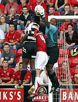 Photo: Dave Linney.<br />Walsall v Darlington. Coca Cola League 2. Coca Cola League 2. 26/08/2006Walsall's .Clayton Inche(R) beats  Kalusivikakoko Ngoma to the ball.