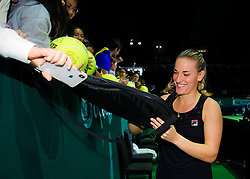 October 26, 2018 - Kallang, SINGAPORE - Timea Babos of Hungary signs autographs after winning their doubles quarterfinal match at the 2018 WTA Finals tennis tournament (Credit Image: © AFP7 via ZUMA Wire)