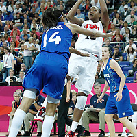 11 August 2012: USA Tamika Catchings takes a jumpshot over Emmeline Ndongue during 86-50 Team USA victory over Team France, during the Women's Gold Medal Game, at the North Greenwich Arena, in London, Great Britain.