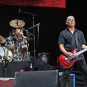 WASHINGTON, DC - July 4, 2015 - Taylor Hawkins and Pat Smear of the Foo Fighters performs at the Foo Fighters 20th Anniversary Blowout at RFK Stadium in Washington, D.C. This was the band's first performance after Grohl broke his leg three weeks ago in Sweden. (Photo by Kyle Gustafson / For The Washington Post)