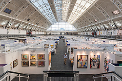© Licensed to London News Pictures. 16/01/2018. LONDON, UK. A general view of the gallery display stands at the preview day of the 30th anniversary of the London Art Fair.  The fair launches the international art calendar with modern and contemporary art from leading galleries around the world and is taking place at the Business Design Centre, Islington from 17 to 21 January 2018.   Photo credit: Stephen Chung/LNP
