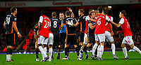 20111227: LONDON, UK - Barclays Premier League 2011/2012: Arsenal vS Wolverhampton Wanderers.<br /> In photo: Arsenal and Wolverhampton Wanderers players clash as Nenad Milijas of Wolverhampton Wanderers (far left) receives a red card.<br /> PHOTO: CITYFILES
