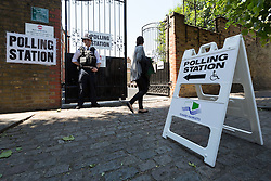 © Licensed to London News Pictures. 11/06/2015. London, UK. A woman enters a polling station near Brick Lane, Tower Hamlets, east London. Tower Hamlets residents go to the polls today to vote for a new Mayor of Tower Hamlets after Lutfur Rahman was removed from office for fraud and corrupt practices by an election court earlier this year. Photo credit : Vickie Flores/LNP