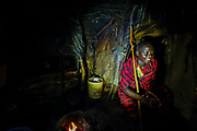 Masai man inside his dark hut. Photographed in Tanzania