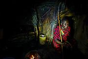 Masai man inside his dark hut. Photographed in Tanzania