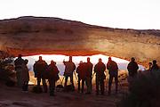 Photographers lining up to take photographs of Mesa at sunrise, Canyonlands National park, Utah, United States of America