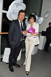 SIMON BURSTEIN and INES de la FRESSANGE at a party hosted by Ines de la Frssange and Bruno Frisoni for Roger Vivier to launch the Roger Vivier book held at The Saatchi Gallery, London on 24th April 2013.
