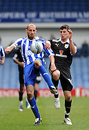 Picture by Graham Crowther/Focus Images Ltd. 07763140036.31/03/12.Rob Jones of Sheffield Wednesday battles with Graham Cummins of Preston North End during the Npower League 1 match at Hillsborough stadium, Sheffield..
