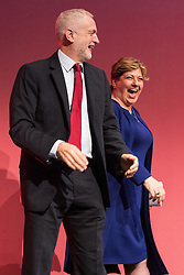 © Licensed to London News Pictures . 25/09/2017. Brighton, UK. EMILY THORNBERRY high fives JEREMY CORBYN after speaking at The Labour Party Conference at The Brighton Centre . Photo credit: Joel Goodman/LNP