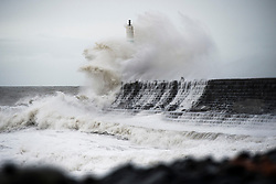 © Licensed to London News Pictures. 29/11/2018. Aberystwyth, UK. For a second day Storm Diana, with strengthening winds gusting up to 70mph in exposed places, continues hammer  huge waves against the sea defences in Aberystwyth on the Cardigan Bay coast of west Wales. The UK Met Office has issued another yellow warning for wind today for western part of the British Isles, with the risk of damage to property, some coastal flooding,  and likely disruption to travel. Photo credit: Keith Morris/LNP