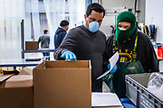 SAN FRANCISCO, CA - OCTOBER 27: Chris Dease (L) and Guillermo Ramos prepare orders for delivery at Water2Table Fish Company in San Francisco, California, U.S. on Wednesday April 08, 2020. Conte initially had to layoff his entire staff at the onset of the COVID-19 shutdown after losing all his restaurant contracts, though quickly pivoted to a consumer-based business model and was able to re-hire nearly everyone within a week. Photographer: Philip Pacheco/Bloomberg
