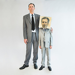 Businessman showing unity and standing near boy wearing mask