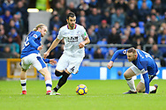 Luka Milivojevic of Crystal Palace (c) makes a break between Tom Davies of Everton (l) and Wayne Rooney of Everton. Premier league match, Everton v Crystal Palace at Goodison Park in Liverpool, Merseyside on Saturday 10th February 2018. pic by Chris Stading, Andrew Orchard sports photography.
