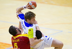Stojanchev Stoilov of Macedonia vs David Miklavcic of Slovenia during friendly handball match between National Teams of Slovenia and F.Y.R. of Macedonia on December 28, 2013 in Sports hall Polaj, Trbovlje, Slovenia. Photo by Vid Ponikvar / Sportida
