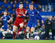 Chelsea's Ross Barkley holds of Liverpool's Andrew Robertson during the English FA Cup fifth round soccer match between Chelsea and Liverpool at Stanford Bridge Stadium, Wednesday, March 3, 2020, in London, United Kingdom. (ESPA-Images/Image of Sport)