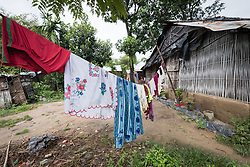 14 September 2018, Damak, Nepal:  Laundry hangs to dry outside a home in the Beldangi refugee camp. Supported by the Lutheran World Federation, the Beldangi refugee camp in the Jhapa district of Nepal hosts more than 5,000 Bhutanese refugees.