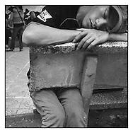 Portrait of a man sleeping on a bench of Hoan Kiem lake in Hanoi