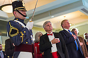 Billionaire and GOP Presidential hopeful Donald Trump stands for the pledge during the Republican Society Patriot Dinner at the Citadel Military College February 22, 2015 in Charleston, South Carolina. Trump and Senator Tim Scott were honored at the annual event.