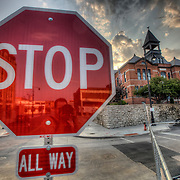 Stop sign by demolition site of former Orion Pictures Building at 17th & Wyandotte in downtown Kansas City, Missouri.