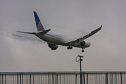 "January 3rd 2015, Heathrow Airport, London. Low cloud and rain provide ideal conditions to observe wake vortexes and ""fluffing"" as moisture condenses over the wings of landing aircraft. With the runway visible only at the last minute, several planes had to perform a ""go-round"", abandoning their first attempts to land. PICTURED: Wake vortices stream from the flaps of a Continental Boeing 787 Dreamliner moments before it lands on Heathrow's runway 27L."