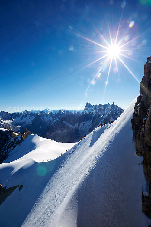 The view from Aiguille du Midi overlooking the French Alps - Chamonix, France (Vertical).
